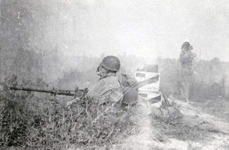"""Although they were considered """"rear echelon"""" troops, the Motor Transport men had to know how to fight. Here, a team mans a .50 caliber M2 machine gun."""