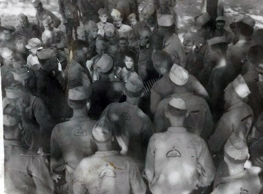 Members of A/1/24 - note UNIS mark on many backs - gather around for a beer party at Camp Maui, summer of 1945.