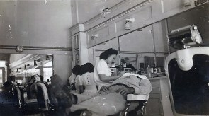 A Marine relaxes for a shave.
