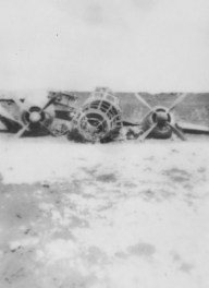 """Saipan's Aslito Airfield was one of the Marines' primary objectives. This G4M """"Betty"""" bomber is little more than an interesting scrap pile."""
