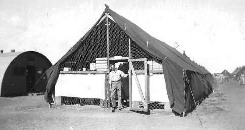 """A battalion surgeon. """"My supply tent, myself and on the left sick bay. Pretty Stateside don't think - but a hell of a ways from it."""""""