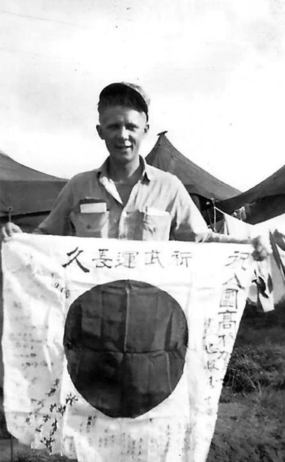 Another man takes his turn. Note this is the same flag as the previous photograph, held at a different angle.