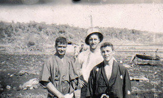 Wood (in helmet) poses with Kenneth Shea and Tom Johnson. They sport Japanese kimonos found on Namur.