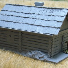 Large cabin with shingle roof.
