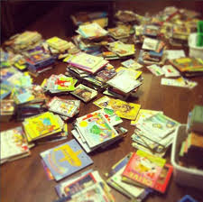 Piles of student books to be sorted.