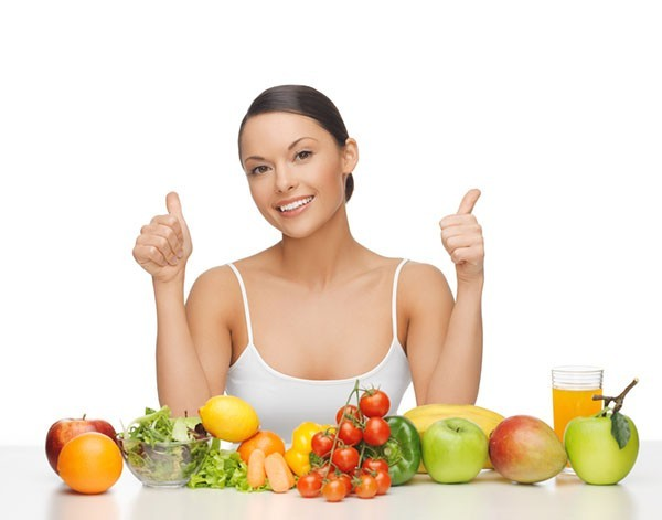 happy woman with fruits and vegetables