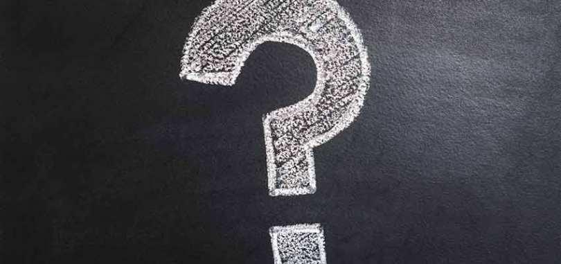 A question mark drawn on a chalkboard.