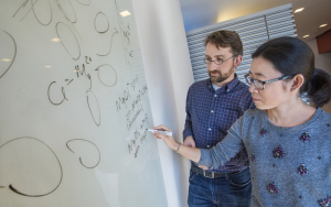 David Prendergast and Liwen Wan at the Molecular Foundry used supercomputer simulations to dispel a popular misconception about magnesium-ion batteries that should help advance the technology in the future. (Photo by Roy Kaltschmidt)