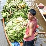 Busy banana man in an Amazonian village.
