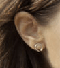 Screen capture of the earrings worn by Scarlet Witch Wanda Maximoff in Avengers 2 Age of Ultron