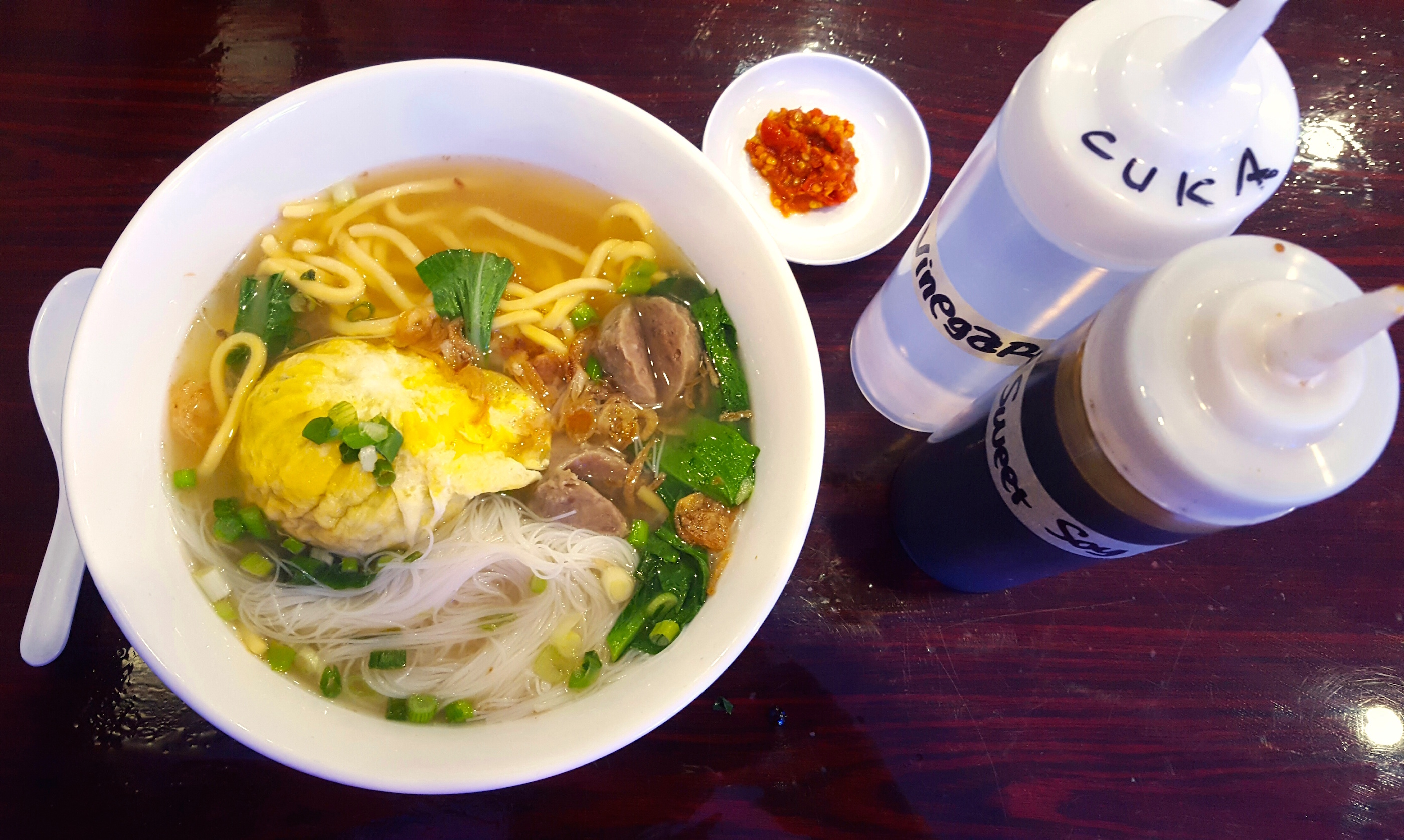 Bakso kabut features a giant meatball shrouded in a fried egg.