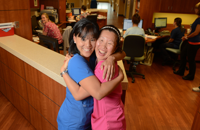 Adopted out of a Korean orphanage as children, sisters Meagan Hughes, left, and Holly Hoyle O'Brien found each other again while working on the same floor at Doctors Hospital of Sarasota. STAFF PHOTO / DAN WAGNER