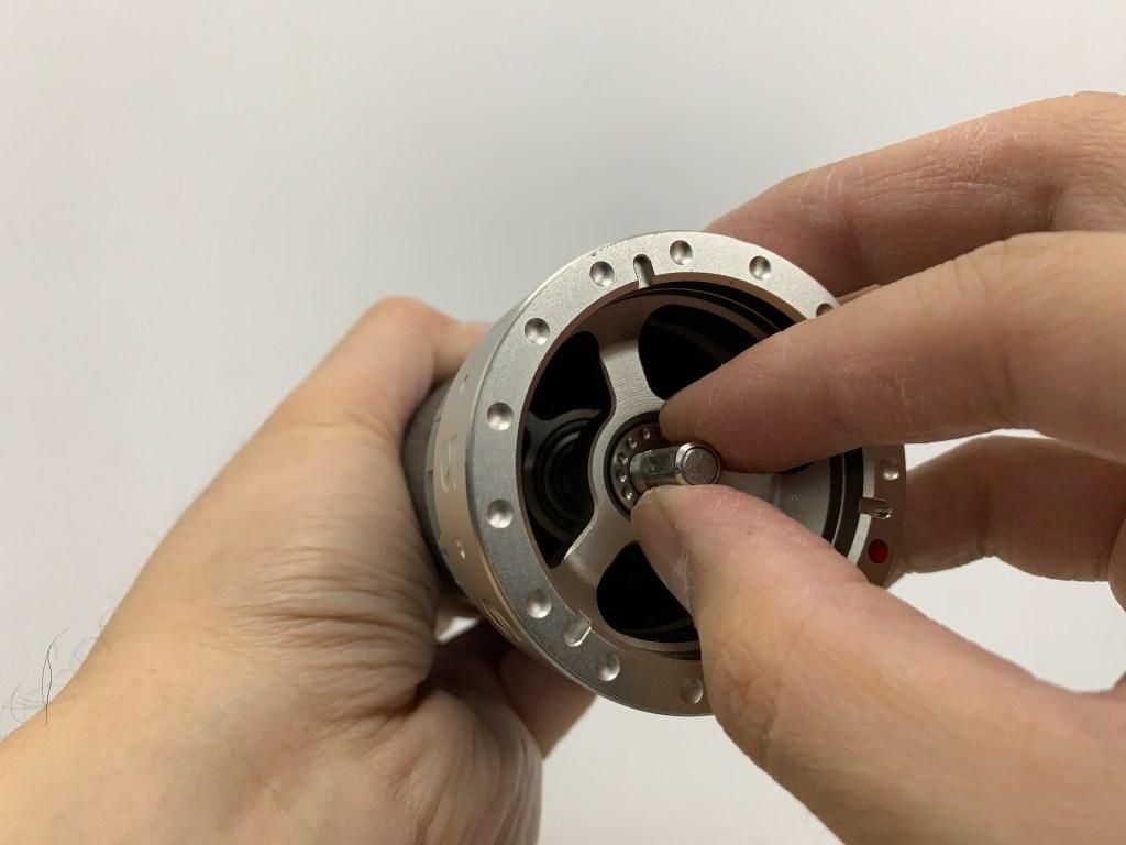 Placing the bearing cap into K-Plus grinder