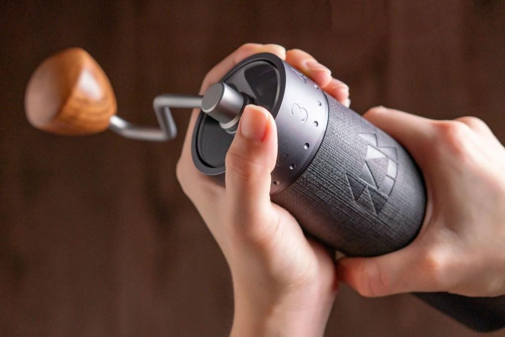 Barista adjusting the external adjustment design of the 1Zpresso J-Max grinder