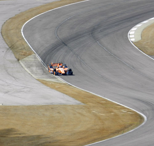 Getting to the track-out point of Turn 1 quickly will line you up for Turns 2 and 3.