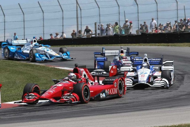 The winning line: Graham Rahal hugs the curbing at the apex of the Keyhole.