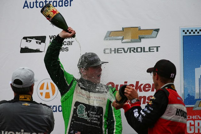 Conor Daly with a champagne shower following his 2nd Place finish in Race 1 of the Chevrolet Dual in Detroit at Belle Isle Park