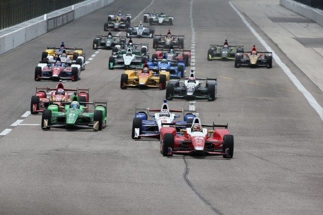 Carlos Munoz leads the field into Turn 3 at the start of the Firestone 600 at Texas Motor Speedway