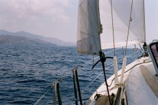 Sailing towards Finikas. After a morning of low winds, we traveled under full sails to Syros.