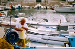 Finikas, on the island of Syros. This sleepy fishing village arose early, as its fisherman tended their nets and repaired their boats.