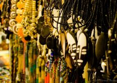 Rows of beaded jewelry hung neatly for sale.