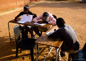 Three of my grade seven learners take advantage of extra lessons held over the winter holidays. Though winter nights can be brutally cold, the midwinter sun can be quite pleasant.