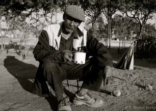Madala - a grandfather - enjoys a cup of tea at the Paile household, just a few doors down from my home.