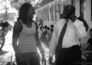 Peace Corps Volunteer Chtaura Jackson laughs with Bakwena chief Rre Mamogale.