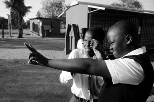Patrol Leader Thabo Mosupye instructs Remoabetswe Lebona in the proper signal mirroring technique, which generates an incredibly bright flash and can be used to signal distress in emergency situations.