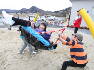 Children enjoy an AAR swing