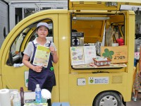 The proud owner, Ms. Kojima, displays her menu