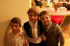 Three cavorting choir members
