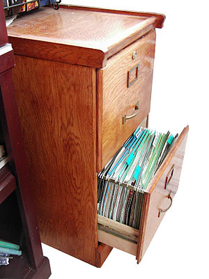 English: Wooden File Cabinet with drawer open....