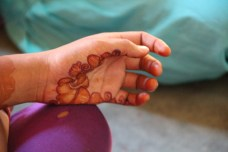 A young girl who did her own mehendi. Photo by Ariana