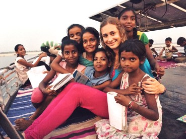 Talia teaching English on the boat school.