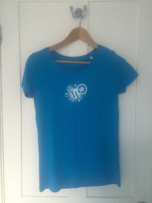 Front of the volunteer t-shirt, with the WordPress logo and gears on the chest