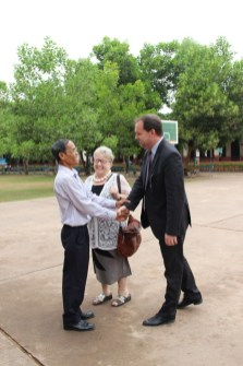 Mr Khamsing Nanthavongdounagsy and Madame Gerlinde Engel welcome Mr Michael Heller from the German Embassy