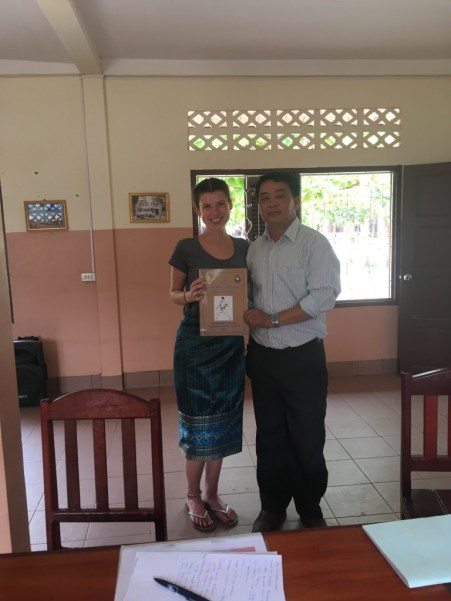 Svenja and Mr Sai, who holds a copy of a book he wrote about karate
