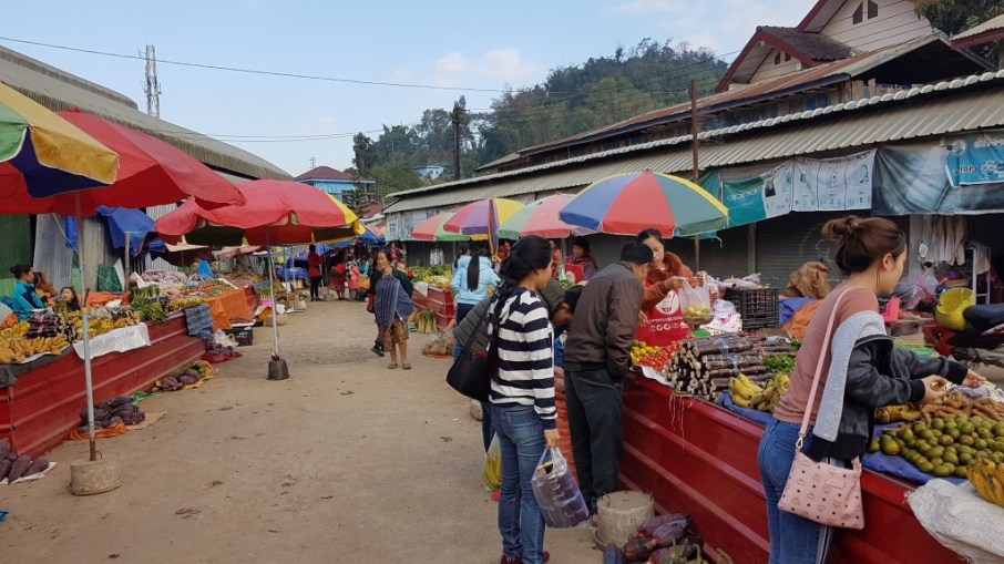 Khamsee takes Jasmin to the markets in Sam Neua to buy food for her and for tonight's dinner.