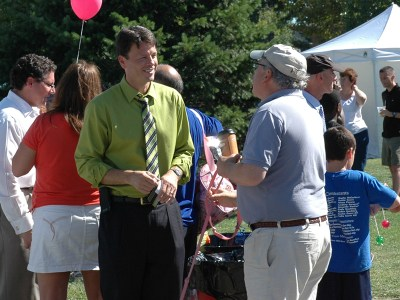 Dr. Dembrowski (L) at a community event.