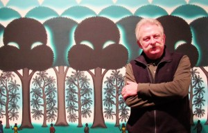 "Curator Brian Byrn with Roger Brown's ""Trees of Heaven"" at MMAA"