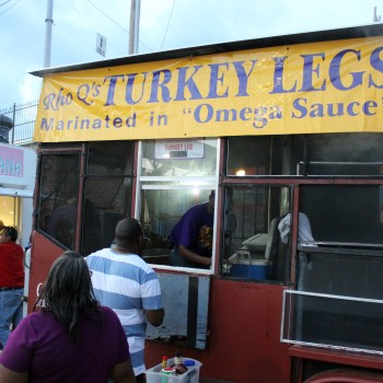 A photo of the Rho Omega smoked turkey legs cart at Shreveport's Let the Good Times Roll Festival