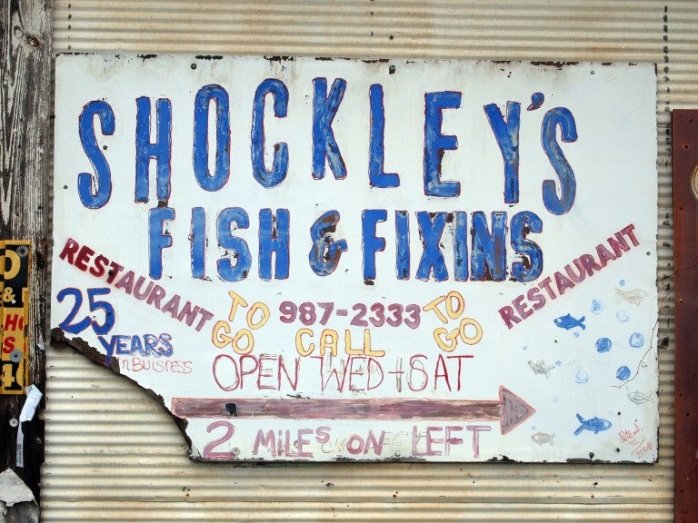 A photo of a sign advertising Shockley's Fish and Fixins