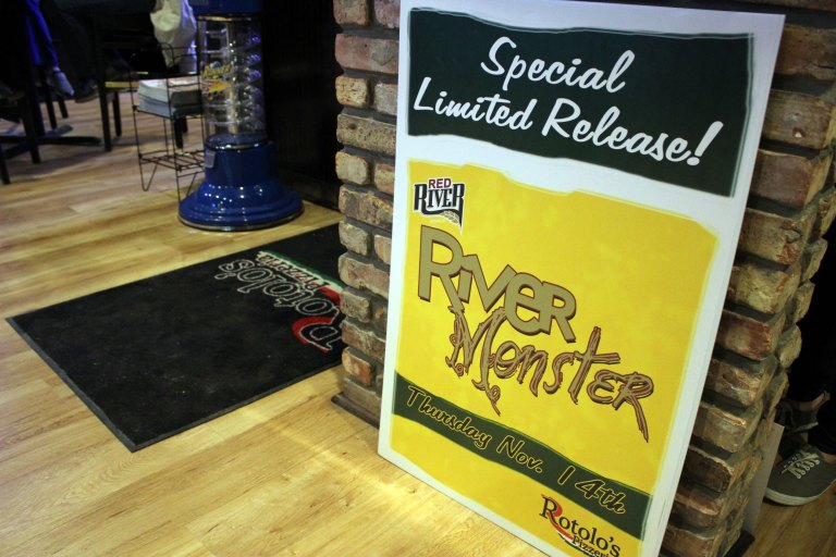 A photo of a promotional sign advertising Red River Brewing