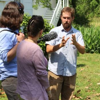 A photo of Louisiana Eats interviewing Evan McCommon