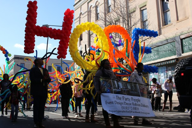Marchers walk in the Krewe of Harambee Martin Luther King Jr. Day Mardi Gras Parade in Shreveport.