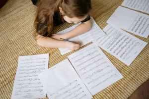girl writing on white paper