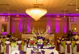 The candy table, uplighting and monogram at the Harris Roberts Wedding