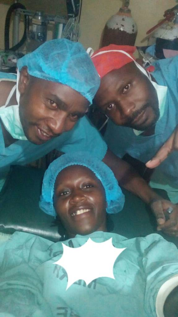 Better days. A smiling Dorothy takes a selfie with doctors in hospital.
