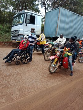Dorothy with boda boda riders as she sets off